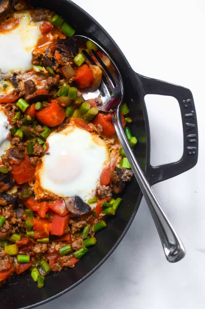 aerial view of shakshuka in cast iron skillet
