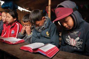 Nepalese children praying