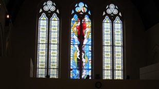 New cross Fire Memorial window, St Andrew's United Reformed Church, Brockley, London, photo by Ana Gobledale