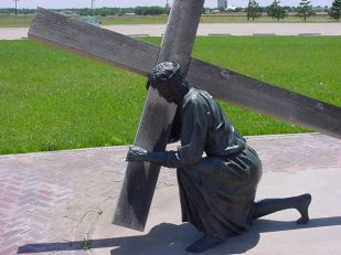 Jesus carrying cross - sculpture