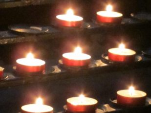 Candles, Church interior, Budapest -- by Ana Gobledale