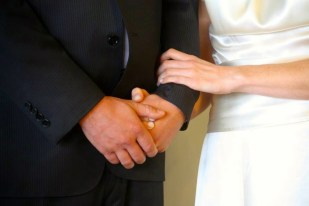 hand of groom and bride