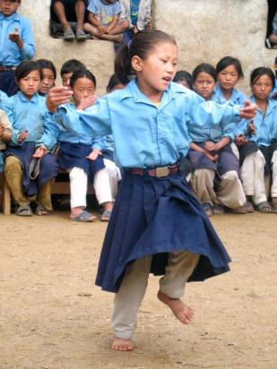 Nepali girl dancing -- by Thandiwe Dale-Ferguson