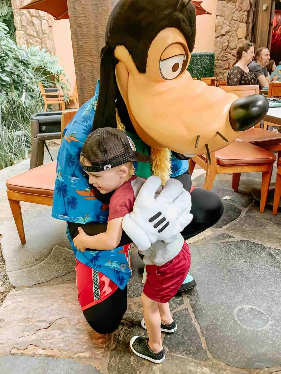 Little boy giving Goofy a hug at the Disney Character Breakfast at Aulani in Hawaii