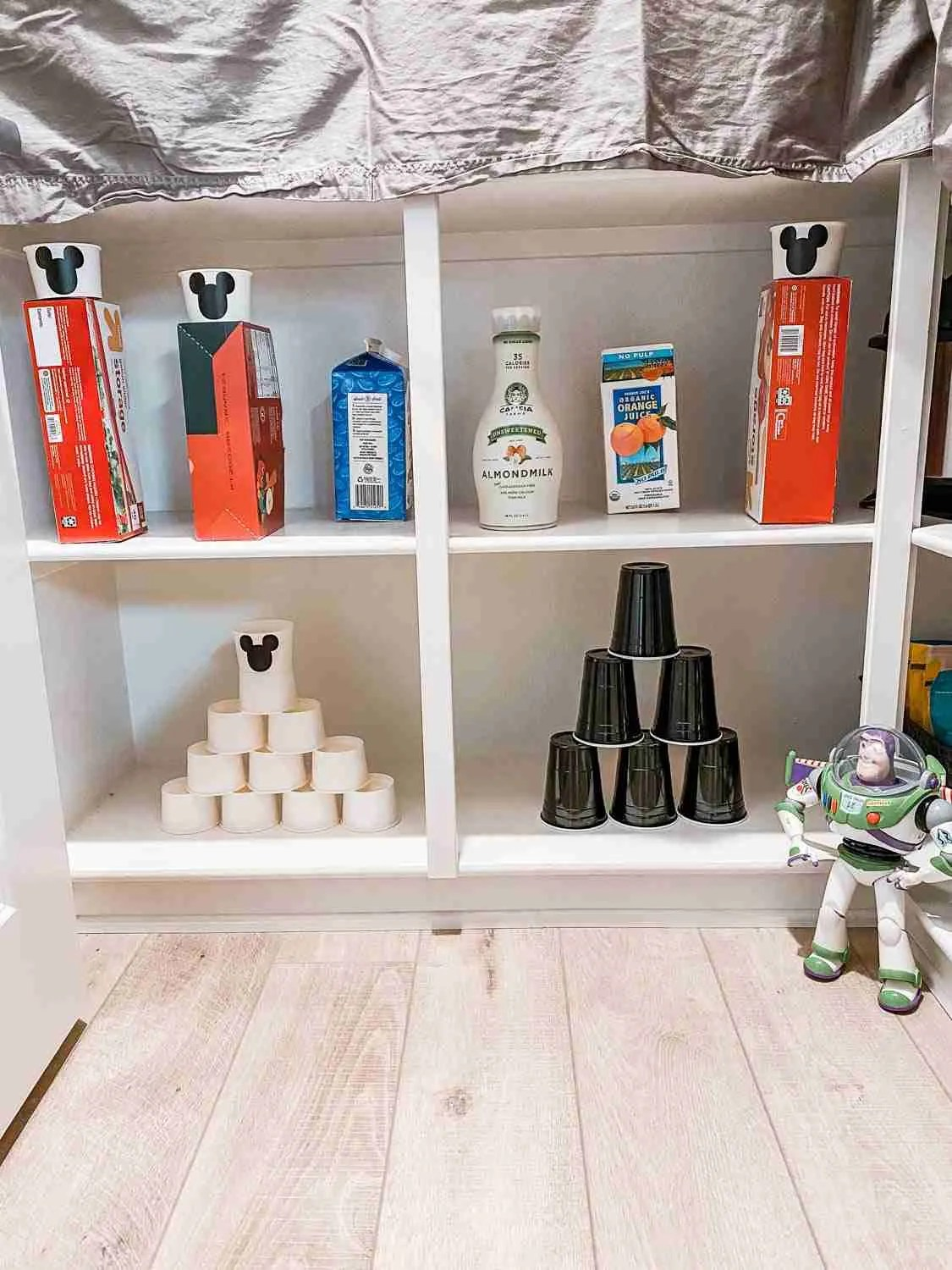 Cups and empty cartons stacked on shelves for Midway Mania game with Buzz for Disneyland at home