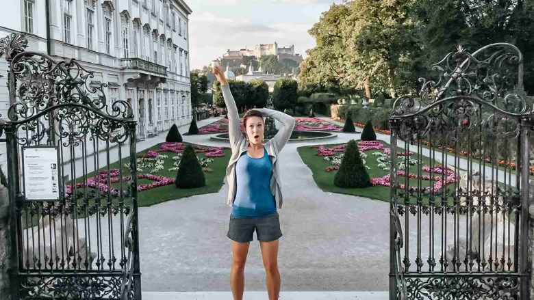 Reenacting Sound of Music poses at Mirabell Gardens in Salzburg