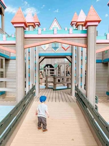 Little boy walking into playground