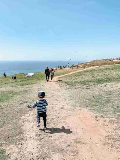 Little boy running across field