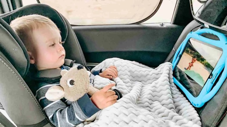 watching a movie on a road trip with a toddler