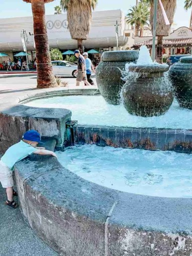 Little boy playing in Palm Springs fountain