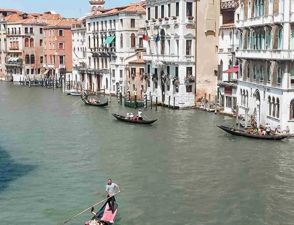 Gondola's floating down Venice Canal in July