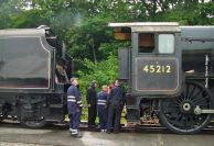 Almost ready, a quick discussion and locomotive and tender come together