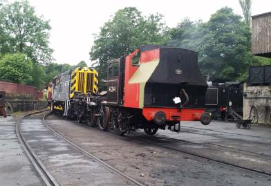 41241, minus the rear pony truck, is towed outside Haworth Shed