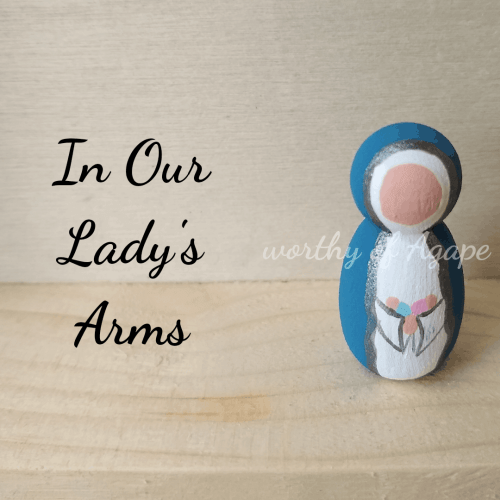 In Our Lady's arms keychain top