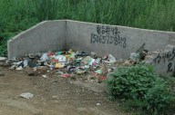 A Trash Pit: a common site in the villages, though most are normally overflowing.