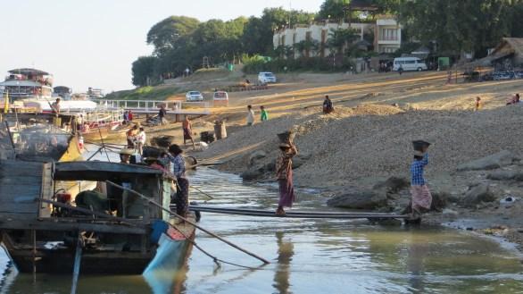 Women Carrying Stones in Bagan