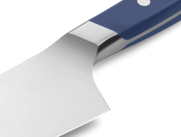 Close up of the back edge of the misen santoku knife showing the D shaped grip.