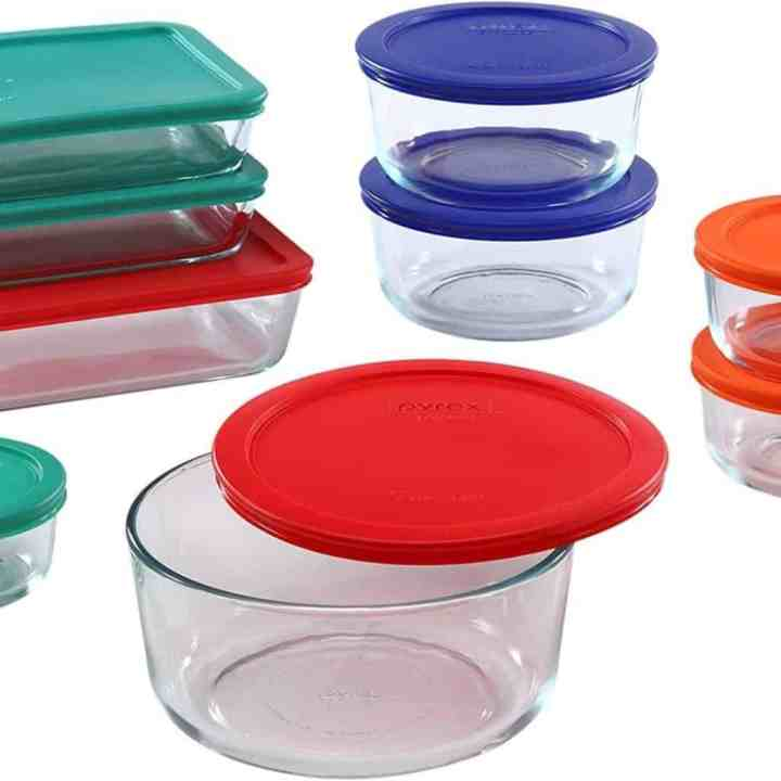 Image of Various Glass Food Storage Containers with Multicolored Lids.