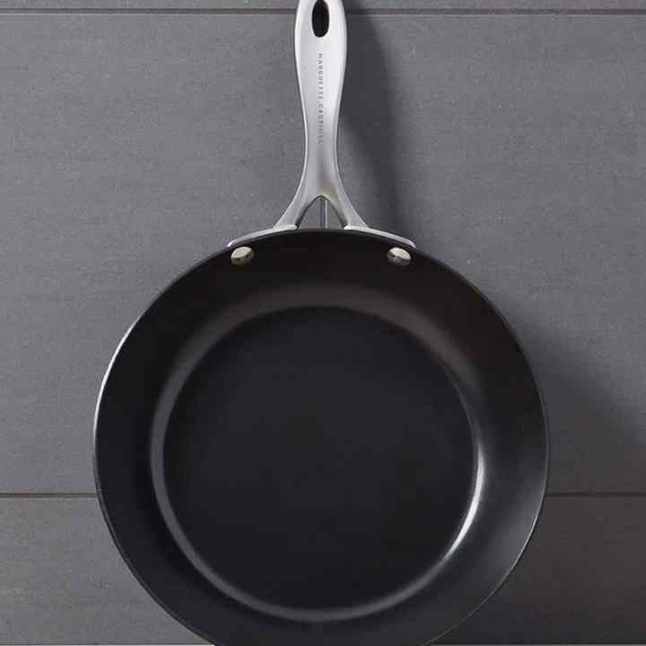 carbon steel skillet against a gray background