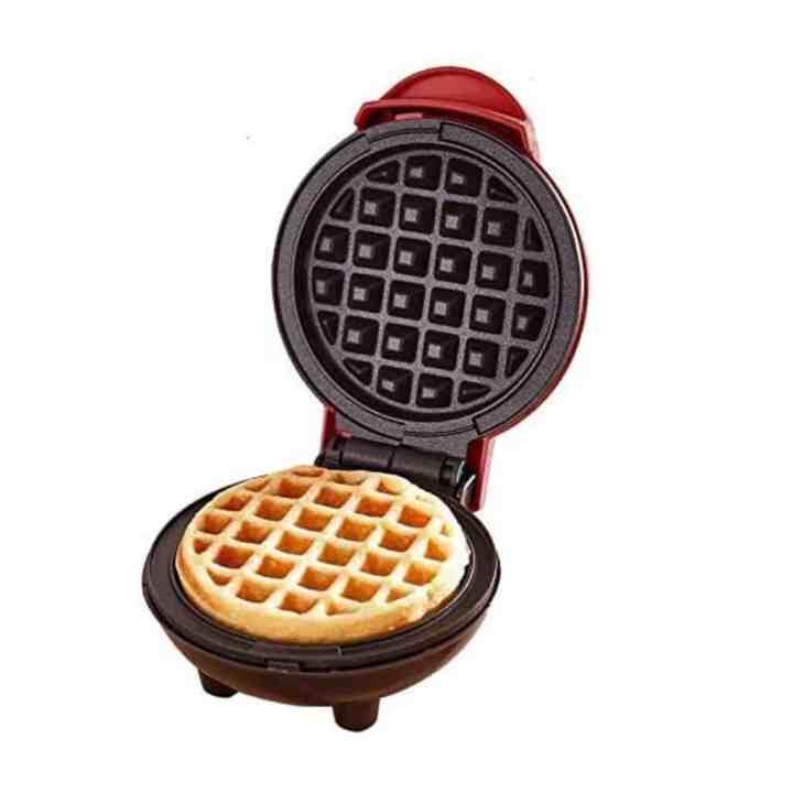 dash mini waffle maker open showing a waffle