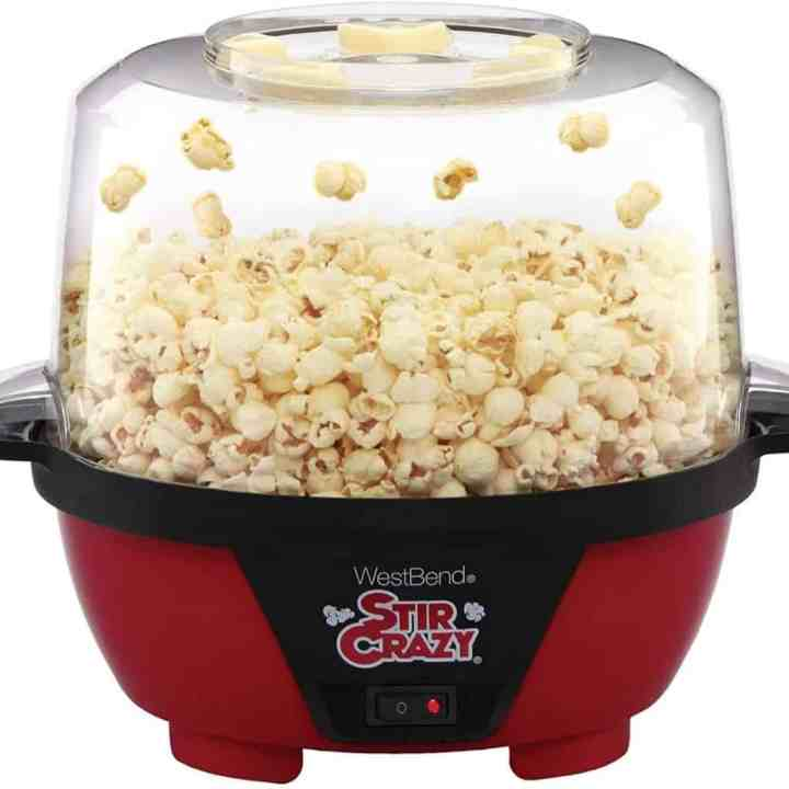 Image of a stir crazy popcorn machine against a white background