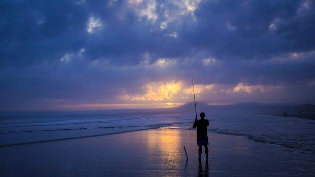 Fisherman using fishing rod