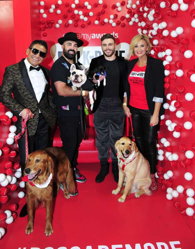 Olympic Silver Medalist and freestyle skier, Gus Kenworthy, poses with Milk-Bone® Dog of the Year nominees, Louboutina the Hugging Dog, Todd the Hero Dog and Pierre Don't Care, who were honored for traits that make them truly special, at the 2018 Streamy Awards.