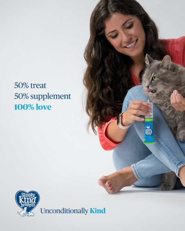 Simply Kind Hearted campaign picture of woman with cat receiving treat