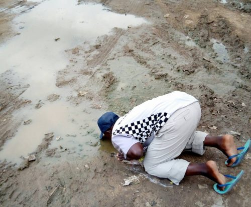 Photos: Nigerian Man Drinks Mud Water In Fulfillment Of Promise He Made, Should President Buhari Return From London