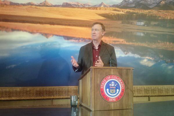 Governor Hickenlooper speaking in December, 2013.