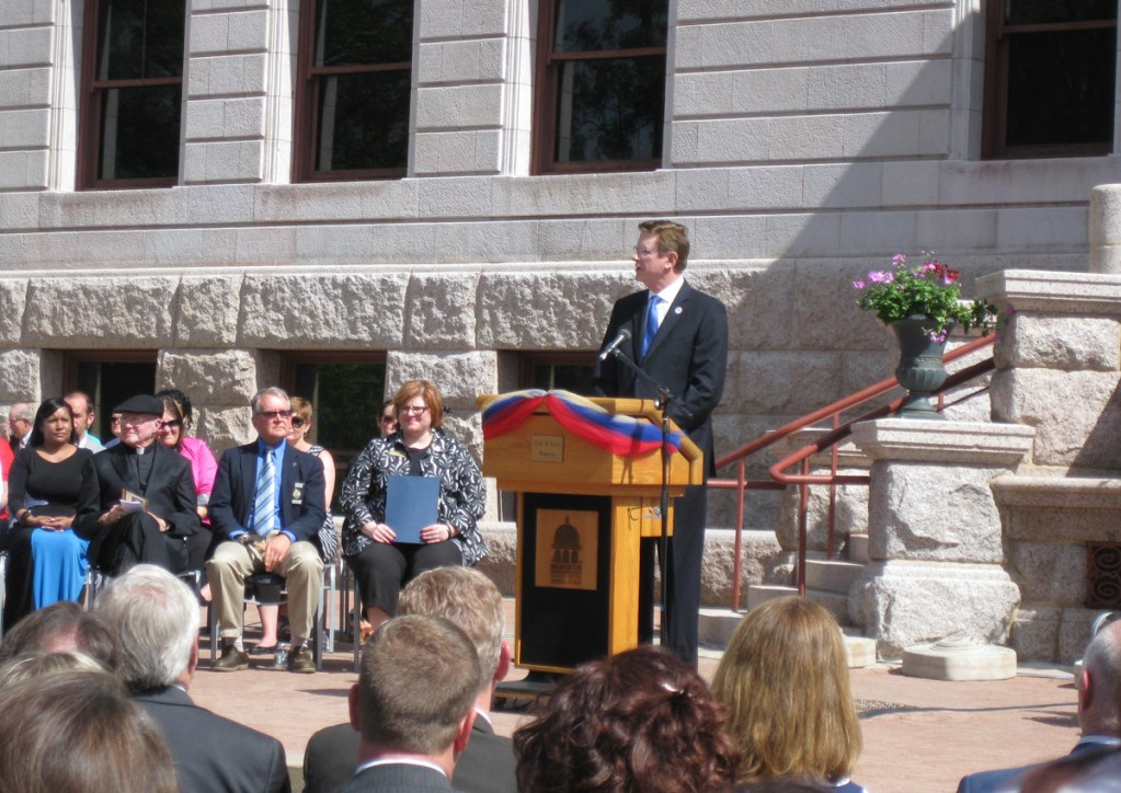 Outgoing Mayor Steve Bach speaks to those gathered for the oath of office.
