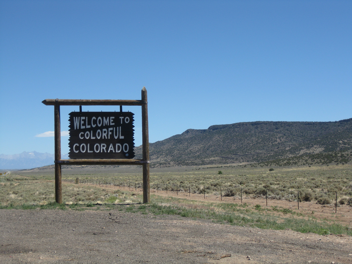 A sign on Route 159 in southern Colorado welcoming travelers to the state. July 2014