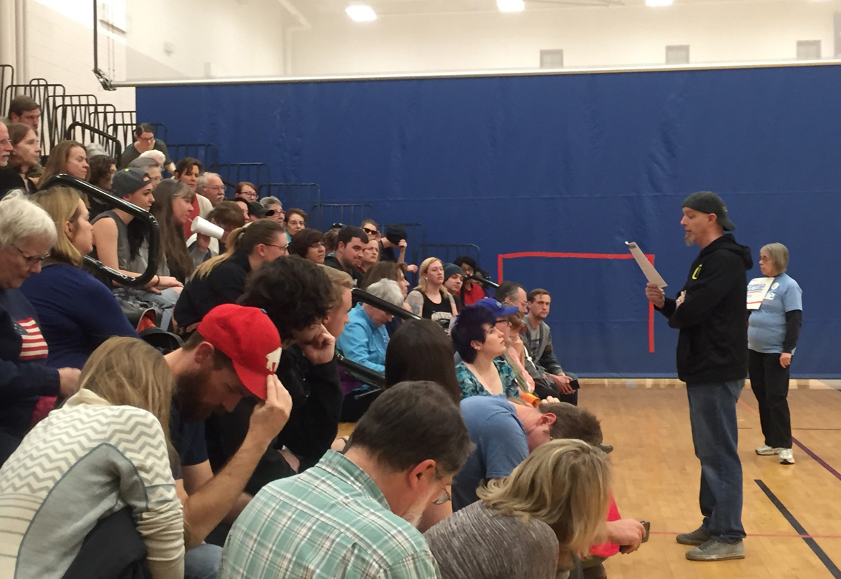 Explaining the caucus rules to a precinct. 34 precincts caucused at Creighton Middle School in Lakewood.