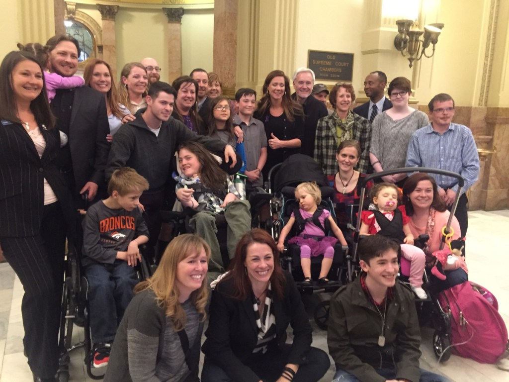 Families and children who use medical marijuana took a picture outside the hearing room after the measure cleared the House Agriculture, Livestock and Natural Resources Committee 10-3.