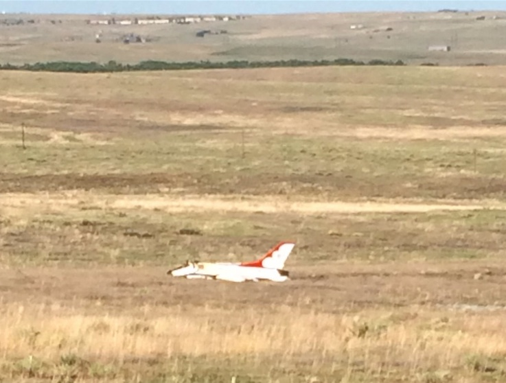 An Air Force Thunderbird F-16 jet crash landed in a field after its demonstration at the Air Force Academy graduation ceremony