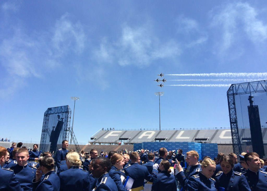 Air Force Thunderbirds fly over the stadium after the ceremonial hat toss