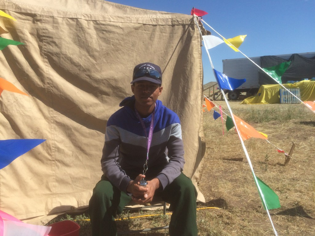 19-year-old Yonas Amine takes a break while working in the Hayden Pass Fire base camp.
