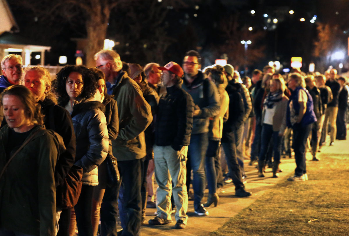 In this March 1, 2016 file photo, voters wait in line for hours to participate in the Colorado Democratic caucus in Boulder, Colo.