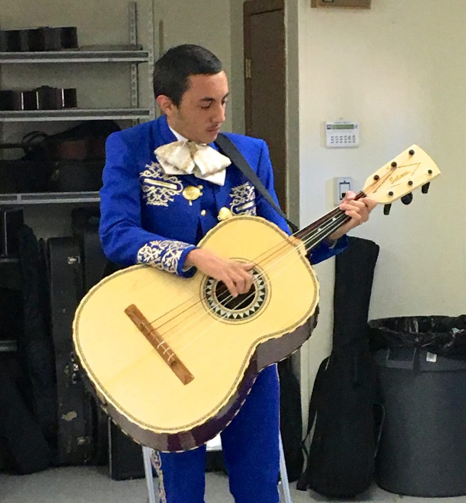 Jeremias Bannister plays guitarron in the mariachi ensemble.