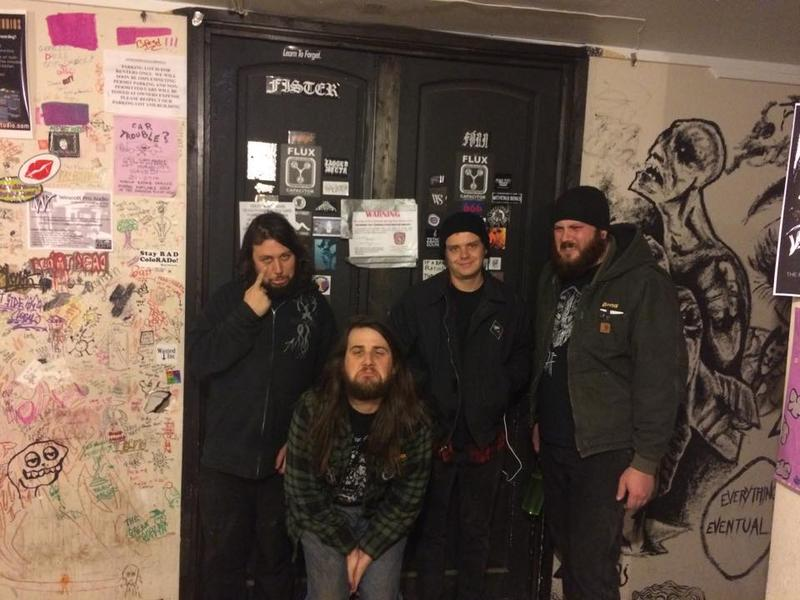 Flux Capacitor co-founders stand beside an eviction notice on the door of the venue.