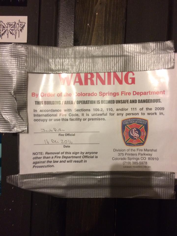 A warning posted on the door of the Flux Capacitor in December notifying tenants that the space was in violation of fire code.