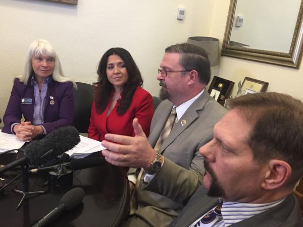 Rep. Diane Mitsch-Bush (D-Steamboat Springs), Speaker of the House Crisanta Duran (D-Denver), Senate President Kevin Grantham (R-Canon City), Sen. Randy Baumgartner (Hot Sulphur Springs) unveil their transportation bill.