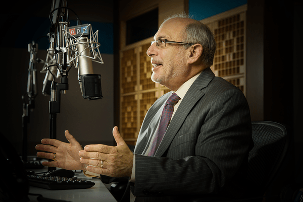Robert Siegel behind the microphone at NPR's studios in Washington, D.C.
