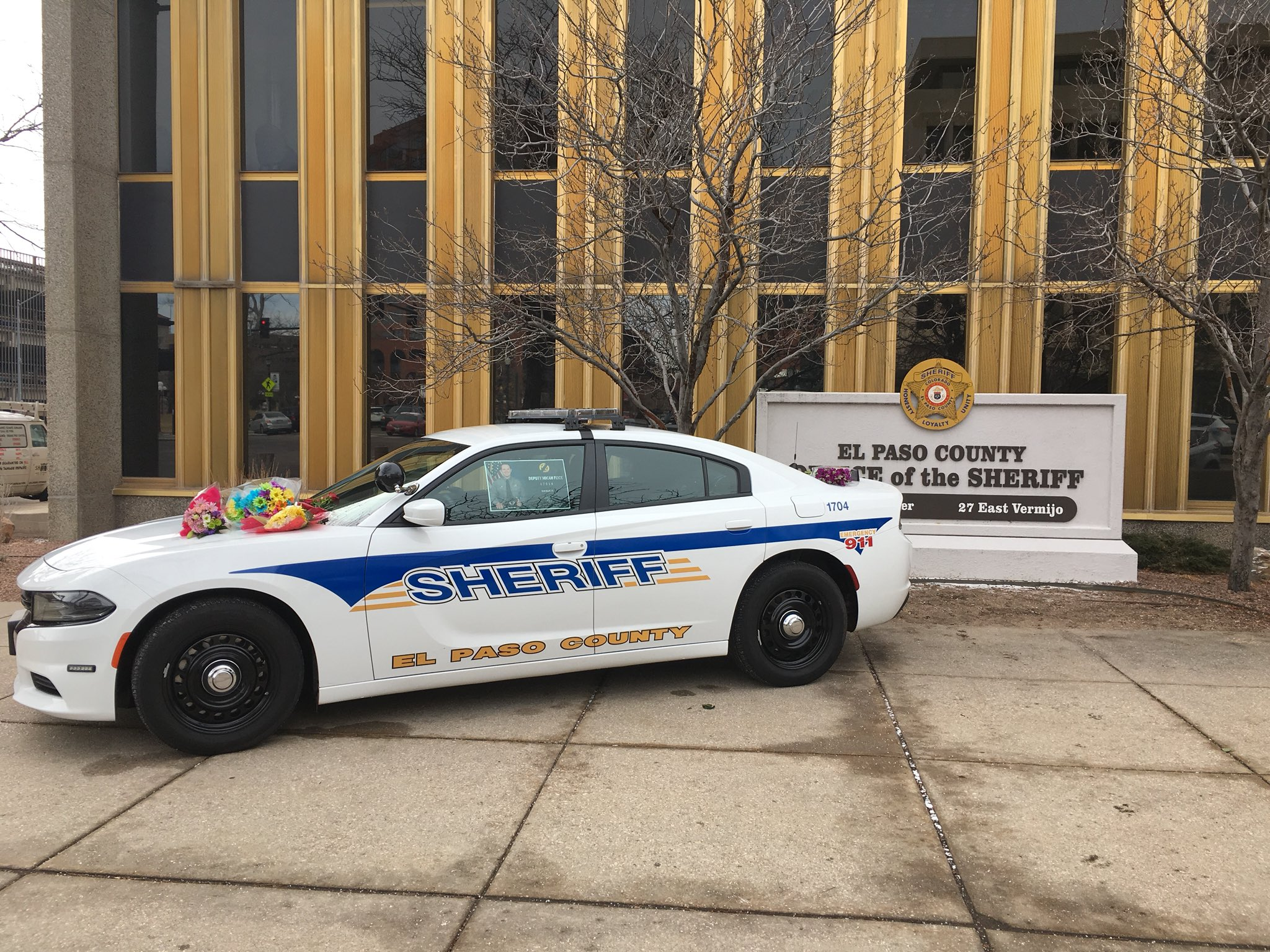 A memorial for Deputy Micah Flick sits in front of the El Paso County Sheriff's Office Tuesday morning.