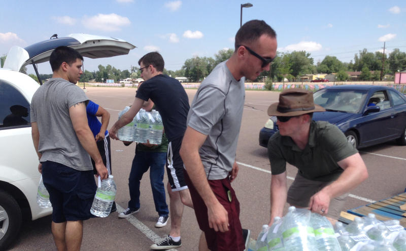 Volunteers with Care and Share Food Bank distributed free bottled water to residents of Security, Widefield, and Fountain as the community grappled with PFC contamination in July, 2016.