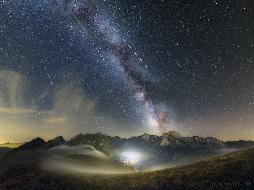 This mountain and night skyscape stretches across the French Pyrenees National Park on August 12, 2017 near the peak of the annual Perseid meteor shower. The multi-exposure panoramic view was composed from the Col d'Aubisque, a mountain pass.