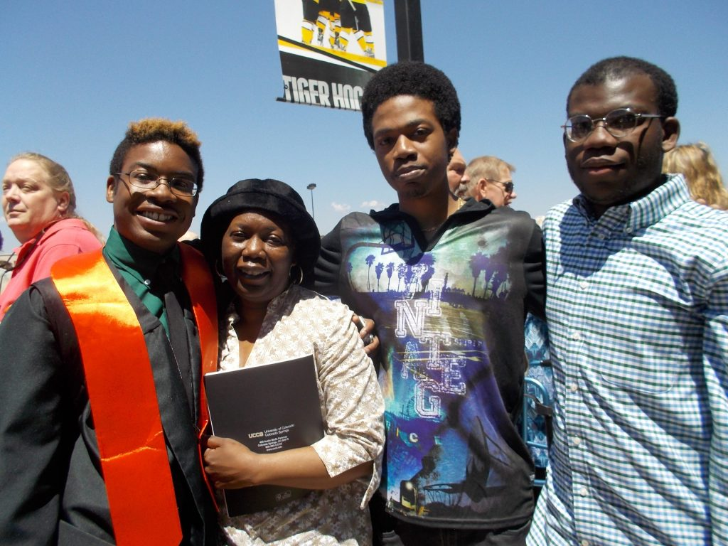 Marcus Wright (second from left) is a Peak Education scholar,Kane Family Foundation scholarship recipient and2017 UCCS graduate.Brother Keenan (at right) is also a Peak Ed scholar, and currently the only Harrrison SD2 graduate to receive aBill and Melinda GatesMillennium Scholarship. Keenanhas completed his first 3 years at CCstudying Chemistry. Brother Justin (center with Mom)was not a Peak Ed scholar, but he too haspursuedpost secondaryeducationat PPCC.