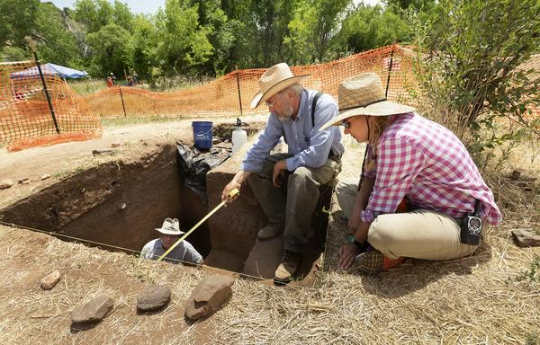 Archaeologists Rolfe Mandel, Mark Mitchell and Michele Koons inspect the excavation site dubbed 'Magic Mountain' in Golden, Colo.