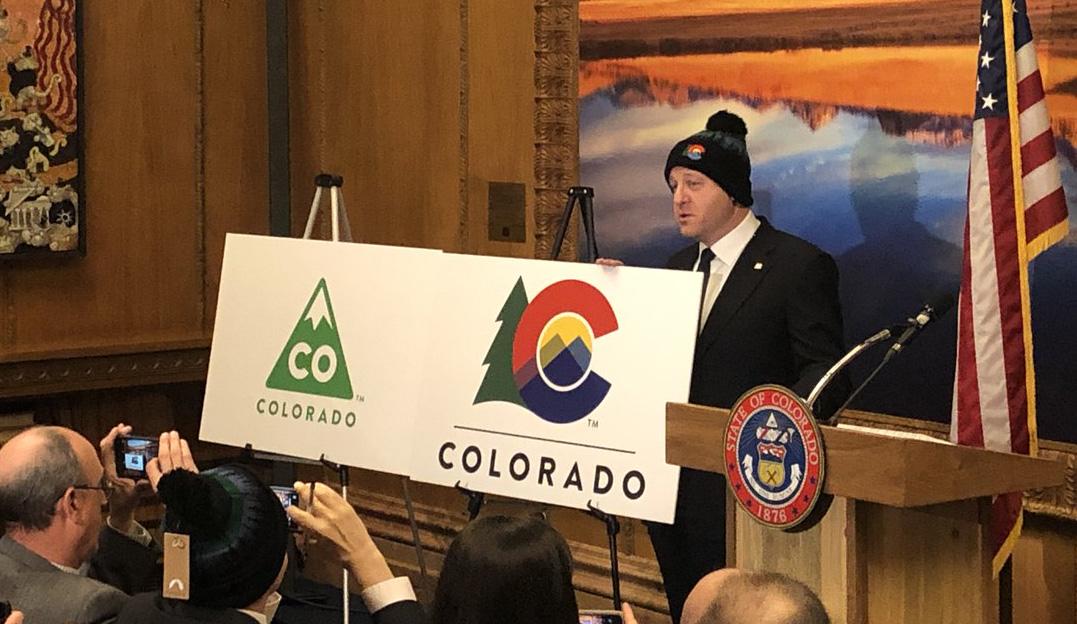 Gov. Jared Polis unveils the new Colorado logo