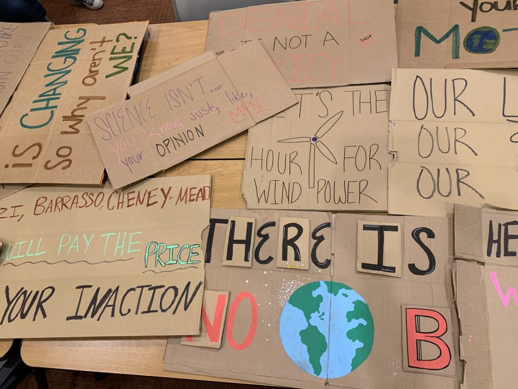 Signs for Friday's strike made by Sienna Taylor and her fellow organizers. Taylor is the state leader for the climate strikes in Wyoming.